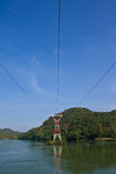Electric pillar in river Stock Image