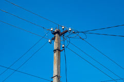 Electric pillar with wires. On dark blue sky Royalty Free Stock Image