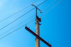 Electric pillar with wires. On dark blue sky Stock Image