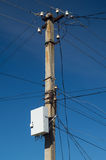 Electric pillar with wires. And internet  box on dark blue sky Stock Images