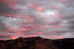 Electric pink sunset over the catalina mountains in Tucson, Arizona. Pink and gray sunset over the catalina montains in tucson, Arizona Stock Image