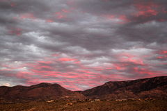 Electric pink sunset over the catalina mountains in Tucson, Arizona. Pink and gray sunset over the catalina montains in tucson, Arizona Royalty Free Stock Photography