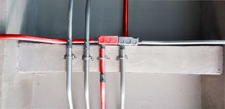 Electric pipes and Red electric pipes for safety systems in building,Cable wiring,Metal pipes in Construction and fire sprinkler. On Red pipe are hanging from royalty free stock photos