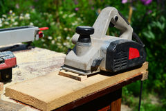 Electric planer is on board on the nature. Electric planer is on the board on the nature Royalty Free Stock Photography