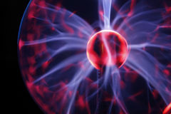 Electric Plasma Sphere & blurred flares. Electric Plasma Sphere with crimson tails and white flares Royalty Free Stock Photo