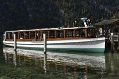 Electric Pleasure Boat at the Lake Königssee near Berchtesgarden, Bavaria, Germany. Electric Pleasure Boat for tourists at the lake Königssee near Stock Photos