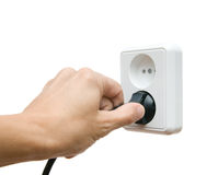 Electric plug. In a hand on a white background stock photos