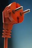 Electric plug. Electric orange plug isolated on white background stock image