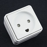 Electric plug on black background. White electrical outlet on a black background Royalty Free Stock Photography