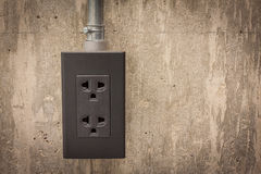 Electric plug on cement wall Royalty Free Stock Photography