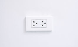 Electric plug. On white wall royalty free stock images