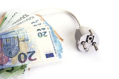 Electric plug with euro money on the white. Energy save concept. Electric plug with euro money on the white. Energy save concept royalty free stock photo
