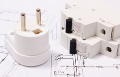 Electric plug and fuse on construction drawing of house Stock Photo