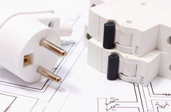 Electric plug and fuse on construction drawing of house Stock Photos