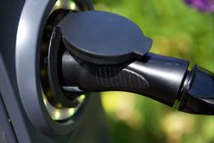 Electric plug for hybrid car Stock Images