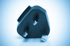 Electric plug isolated UK. color processed blue Royalty Free Stock Images