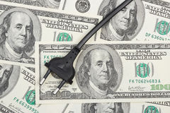 Electric plug on money Royalty Free Stock Image