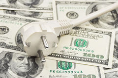 Electric plug on money Stock Images