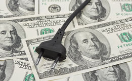 Electric plug on money. Business background Stock Image
