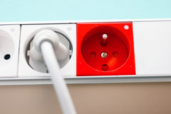 Electric plug in a socket Royalty Free Stock Photos
