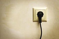 Electric plug in a socket Stock Photos