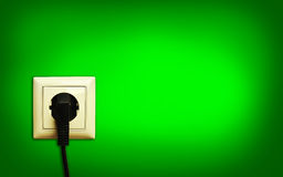 Electric plug in a socket Royalty Free Stock Images