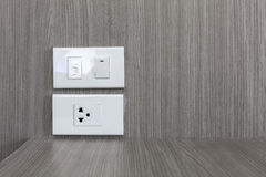 Electric plug socket and telephone port on the wood wall. Royalty Free Stock Photos