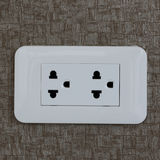 Electric plug on the wall Royalty Free Stock Photo
