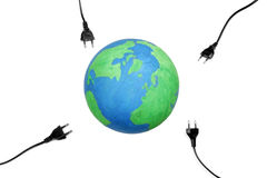 Electric plugs on earth Stock Images