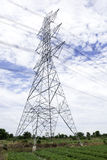 Electric pole. A high voltage electric pole on green field Royalty Free Stock Photos