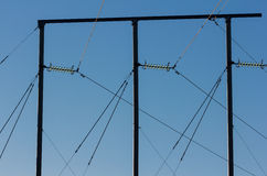 Electric pole against a blue sky Stock Photography