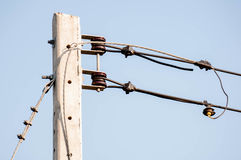 Electric pole on blue sky backgound Royalty Free Stock Images