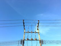 Electric pole on blue sky background. Electric pole with cable on blue sky background Stock Images