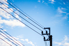 Electric pole with blue sky  and clouds. Energy Royalty Free Stock Photos