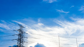 Electric pole with blue sky and clouds Stock Images