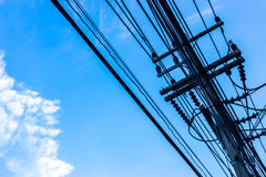 Electric pole with blue sky and clouds Stock Image