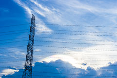 Electric pole with blue sky and clouds Royalty Free Stock Photography