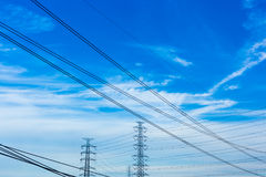 Electric pole with blue sky and clouds Royalty Free Stock Photo