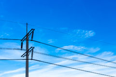 Electric pole with blue sky and clouds Stock Photography