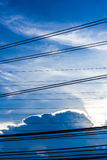 Electric pole with blue sky and clouds Royalty Free Stock Images