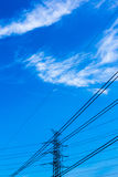 Electric pole with blue sky and clouds. Energy Royalty Free Stock Image