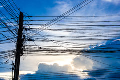 Electric pole with blue sky and clouds Stock Photos