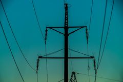 Electric pole, blue sky. Electric pole, blue evening sky Royalty Free Stock Images