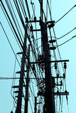 Electric pole with blue sky. In Thailand Royalty Free Stock Photos