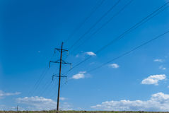 Electric pole in blue sky. Royalty Free Stock Photo