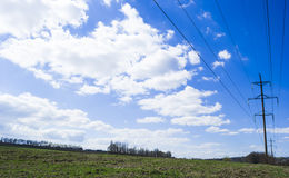 Electric pole in blue sky. Royalty Free Stock Image