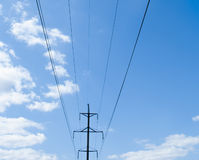 Electric pole in blue sky. Royalty Free Stock Photography