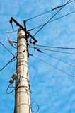 Electric pole with cables Royalty Free Stock Photography
