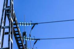 Electric pole. Closeup of electric pole on a blue sky Stock Photo