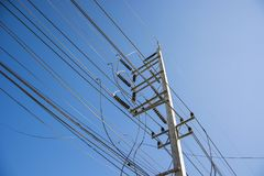 Electric pole. Power lines and wires with blue sky Royalty Free Stock Images